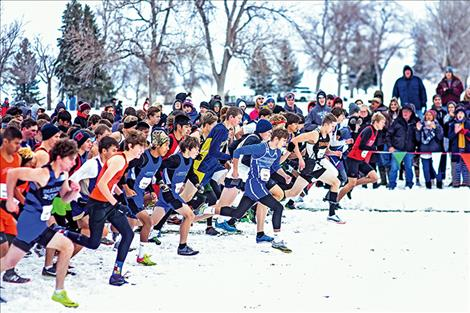 Boys run at the gun during the start of the Boys State B championship, despite chilly temps and snow.