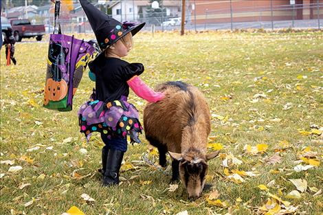 Creatures prowl the parking lot at the New Life Church in Polson on Saturday during the annual Pumpkin Patch Bash.
