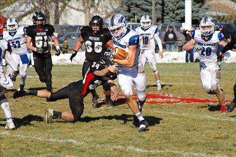 Troy Matt eludes the Panther defense for a 60-yard sprint to the end zone during Saturday's playoffs in Park City.