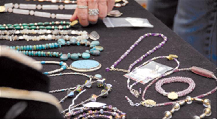 Jewelry by watercolorist Joanne Simpson is displayed at the art festival.