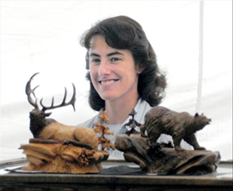 Joan Kosel displays wildlife carvings she creates. Kosel has been carving for 16 years.