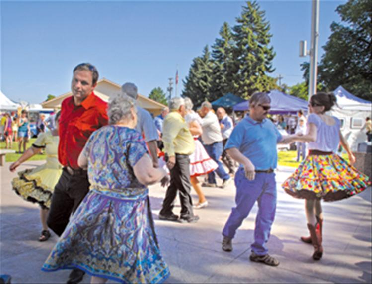 The Polson Paddle Wheelers square dance group do-si-do and swing their partners as they perform in front of the Lake County Courthouse during the Sandpiper Lake County Art Festival on Aug. 11.