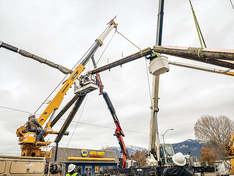 Facelift: Framing for the newly restored iconic arch is erected on Main Street, Ronan. A support crew of more than 30 workers plus multiple cranes and rigs helped complete the engineering feat. See next week's issue for full story.