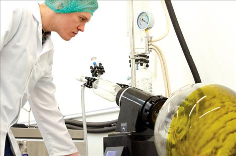 Jake Hastig, Green Ridge Biosolutions office manager, demonstrates how CBD oil is manufactured.