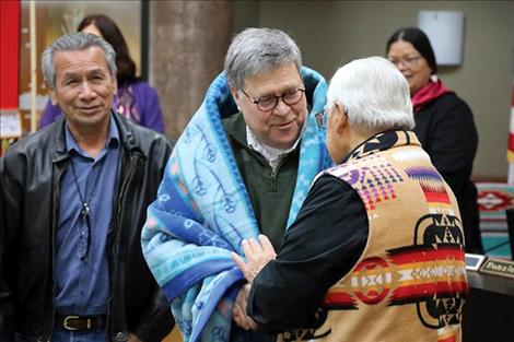 Barr was gifted a blanket before an honor song was sung. From left, Vernon Finley, director of the Kootenai Culture Committee, US Attorney General William Barr and Tony Incashola, director of the Selis Qlispe Culture Committee