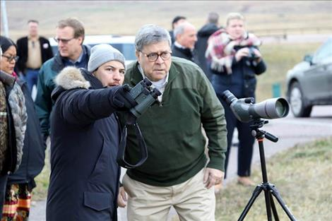 CSKT Attorney Shane Morigeau points out bison in the distance for United States Attorney General William Barr.