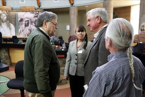 Barr speaks with Alan Mikkelsen after speaking with tribal Council. Council woman Anita Matt and Council Vice Chair Leonard Gray observe the talk.  Mikkelsen is the Senior Advisor to the  Secretary of the Interior on Western and Water Issues and Chair of the Secretary's Indian Water Rights Working Group.