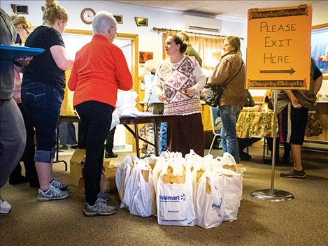Ready-to-go Thanksgiving meals await pick-up at the  Polson Senior Center.