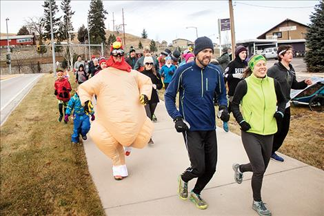 Runners who dressed for the occasion in festive outfits received a 30-second head start.