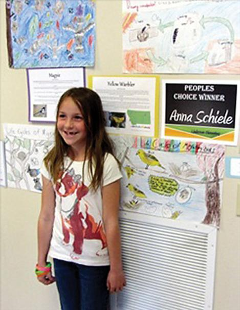 Anna Schiele won the People's Choice award for her poster entry at the International Migratory Bird Day event May 23 at SKC.
