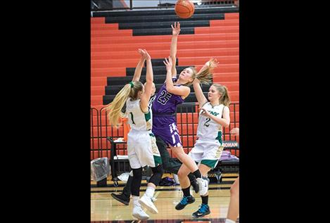 Charlo Lady Viking Brooke Alder glides to the hoop.