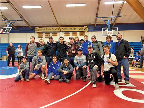 The Mission/Charlo wrestlers proudly pose for a photo after a second-place team finish at the Bob Kinney Classic.