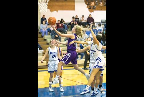 Charlo Lady Viking Carlee Fryberger races past the defense for two points.