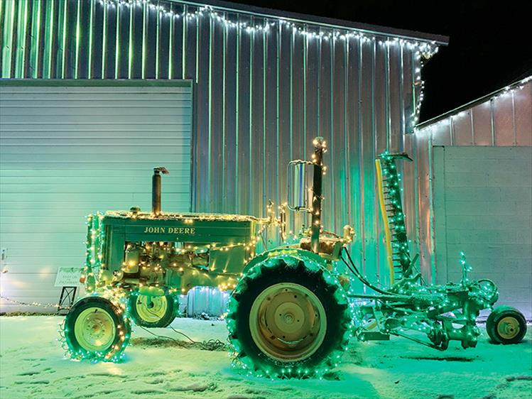 "All lit up: A tractor provides a medium for sparkling lights at the ""Lights Under the Big Sky"" event in Ronan."