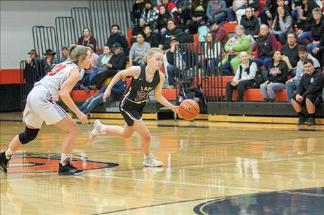 Lady Pirate Anna Cogar races down court with the ball.