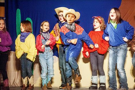 Ronan students perform a country play on Saturday at the elementary school.