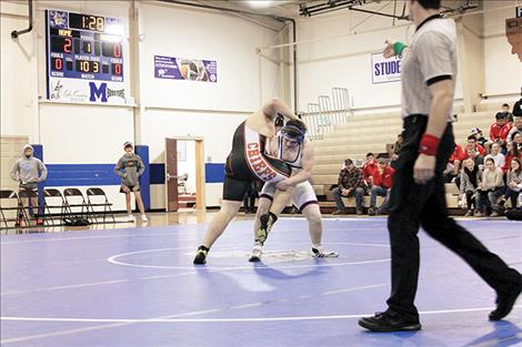 Mission and Ronan wrestlers battle in quad action on Thursday.