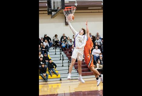 Polson Pirate Colton Graham lays it up for a score.