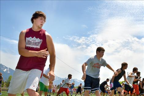 Football players practice their quickness and agility in drills run by University of Montana football players during Ronan's football camp.