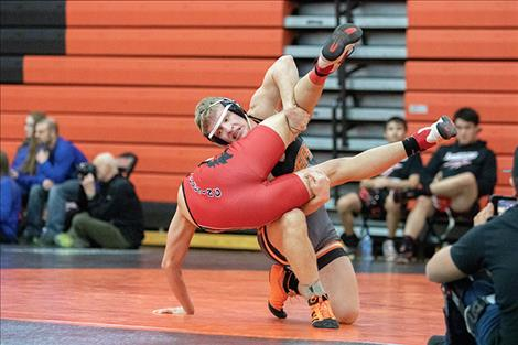 Ronan Chief Daniel Collins Bishop takes down a Browning opponent during divisional consolation action.