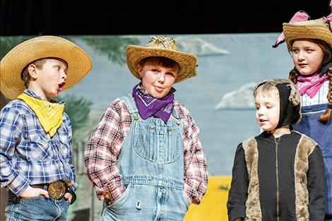 Farmers Landon Dolberry, Aiden Takacs, cat Austin Takacs and country mouse Lara-Jean Duran play in Saturday's show.