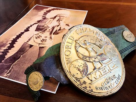 Marvin Camel's photo and his World Champion boxing belt.