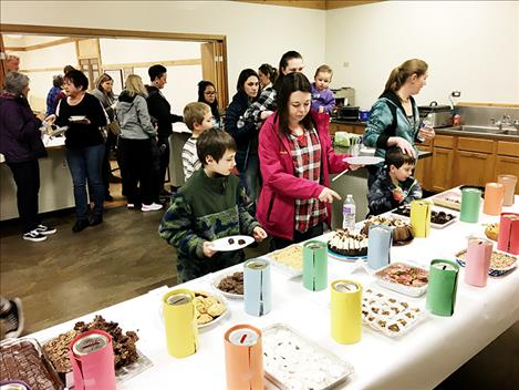 Participants enjoy chocolate treats at the Arlee Brown Building during the 16th Annual  Chocolate Lover's Festival.