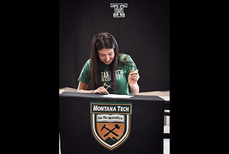 Mission Lady Bulldogs Karolyna Buck signs her national letter of intent to continue both her cross-country and track career at Montana Tech.