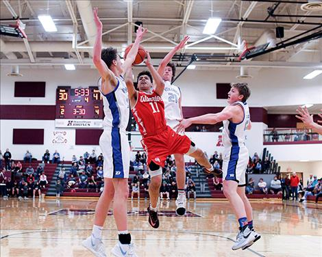 Arlee Warrior Cody Tanner grabs a  rebound during Western B Divisional bracket play.