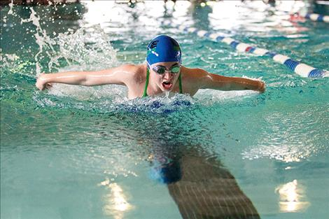 Lake Monster swim team member Aspen McKee races to a first place finish in the 50-yard butterfly.