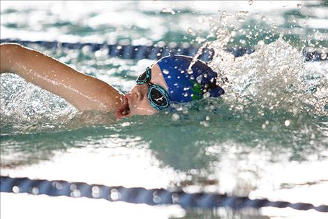Lake Monster swim team member Truman Sawyer swims to the finish line in the 100-yard freestyle.