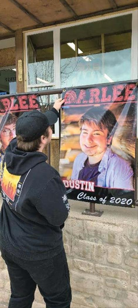 Arlee graduation banners are set up around town.