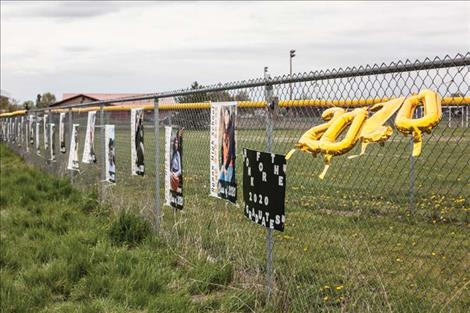 Ronan High School senior banners decorate the fence along U.S. Highway 93 in Ronan.