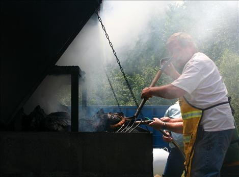 Firefighters brave the heat to feed the crowd