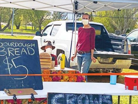Zach Johnson and Brianna Ewert of Crows View Organic Farms display their fresh-baked bread.
