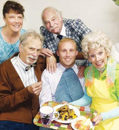 """Jeri Currie, Neal Lewing, Ron Martin-Dent and Karen Lewing play loving grandparents to their grandson Nick Marquardt, center, in """"Over The River And Through The Woods."""" The show was slated to play July 30. Plans are being made to open the show next year."""
