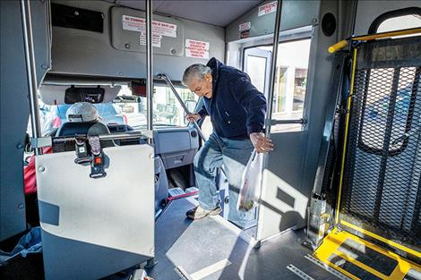 fter shopping at The Corner Store, Whitehall resident Bruce Ball boards a Whitehall Public Transportation bus driven by  LeRoy Murphy Feb. 21, 2020. (Ball has since passed away.)