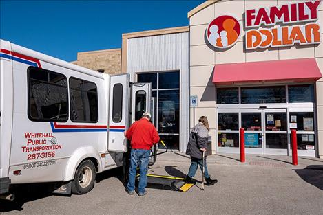 Whitehall resident Dee McHugh goes to shop at Family Dollar after Whitehall Public  Transportation bus driver LeRoy Murphy let her off the bus Feb. 21, 2020.
