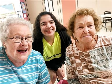 Teeniors participants Linda Haverty, Kendra Gonzales and Mary Frame pose for a photo.  Elderly adults feel they are treated with respect and teens feel they are making a difference.