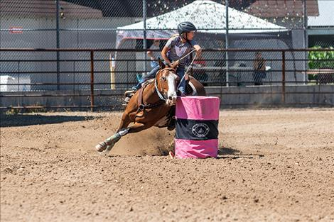 Brielle  Zempel rounds the second barrel and sets her eyes on the third during the barrel racing event at the Lake County Fairgrounds.