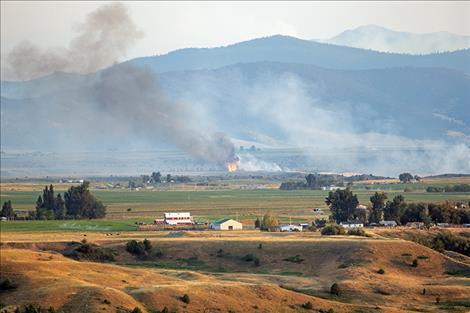 The Polson area fills with smoke due to a human-caused fire.