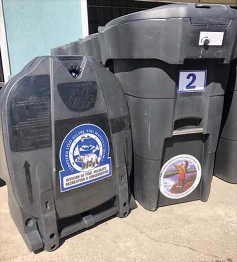 Examples of 65-gallon bear-resistant garbage cans, available through the Confederated Salish and Kootenai Tribes' Wildlife Management Program.