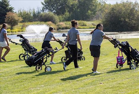 The Ronan Maidens' golf team makes their way to the next tee box.
