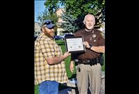 Sheriff's report: man who saved other from fiery crash honored