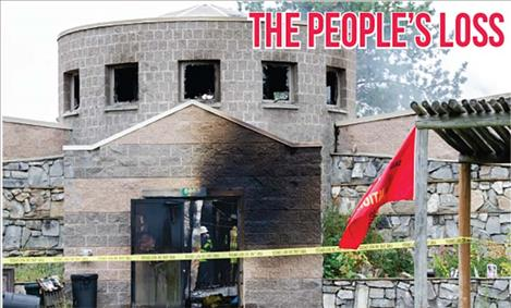 Smoke still billowed from the People's Center on Monday morning.