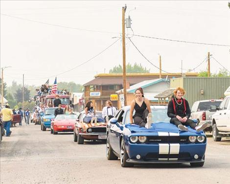 The Mission Homecomming court makes their way down the parade route.