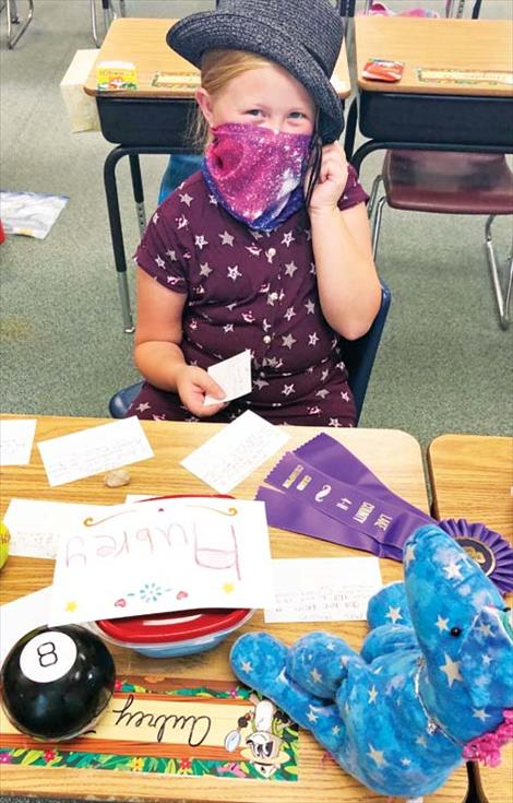 A Polson second-grade student wears a mask in class.