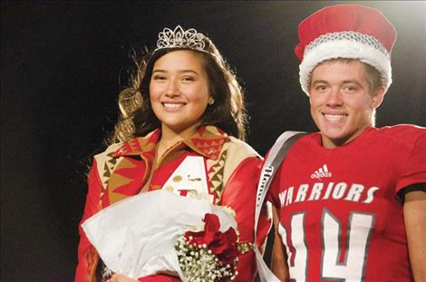 Arlee Homecoming Queen Halle Adams and King Colt Crawford pose for a photo.
