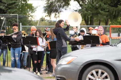 The RHS band plays the school's fight song along the roadside during the reverse homecoming parade.