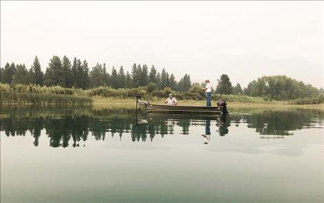 Fishermen angle for bass on the Flathead River near Dixon.